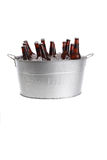 Beers in a bucket. Ice cold beer in a metal silver bucket Royalty Free Stock Photos