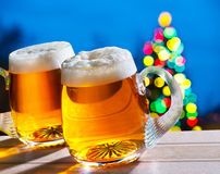 Beers and Christmas tree Stock Photography