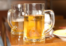 Beers mugs. A glass beer mug filled with beer Stock Photo