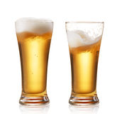 Beers. Two glasses of beer isolated on white stock photos