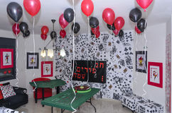 Beersheba, Israel. March 24,Room for a party in the style of a casino with scarlet and black balloons and a table Stock Photo