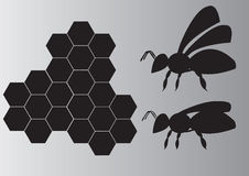 Bees. The bees and honeycomb on a black background stock illustration