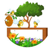 Bees cartoon holding flower and a beehive with blank sign Stock Photo