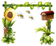 Bees in the garden with a mailbox Royalty Free Stock Photography