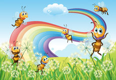 Bees at the hilltop and a rainbow in the sky vector illustration