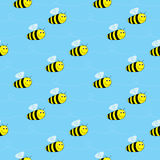 Bees seamless pattern. Seamless illustrated pattern made of cartoon bees on blue Royalty Free Stock Photography