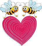 Bees. Two cartoon bees that are in love with a heart design royalty free illustration