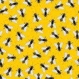 Bees on a yellow background. Vector seamless pattern royalty free illustration