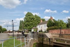 Beeston lock. The lock keepers cottage to the side of Beeston lock signposting the way from Attenborough towards Nottingham stock image