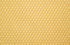 Beeswax. Close up structure of yellow beeswax as background stock photos