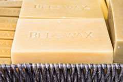 Beeswax. Blocks of beeswax in a basket stock images