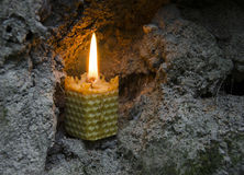 Beeswax candle. Burning beeswax candle in the cave stock photos