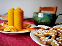 Beeswax candles, dried oranges and gingerbread Royalty Free Stock Photos