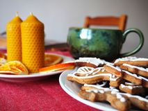 Beeswax candles and gingerbread Stock Images