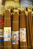 Beeswax Candles and Incense for Pilgrims to the Church of the Holy Sepulchre, Jerusalem, Israel. Detailed view of bundles of beeswax candles and packages of Royalty Free Stock Photos