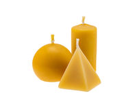 Beeswax candles isolated over white. Three golden beeswax candles isolated on white background stock image