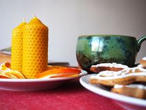 Beeswax candles and tea cup Royalty Free Stock Photography