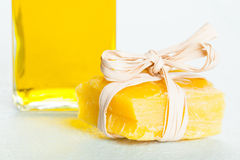 Beeswax piece and a bottle of olive oil Royalty Free Stock Image