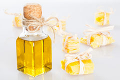 Beeswax pieces and a bottle of olive oil Stock Image