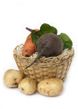 Beet. Vegetables in a yellow basket on a white background Stock Images