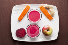Beet apple ginger and carrot juice Royalty Free Stock Image