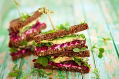 Beet,avocado and arugula sandwich Royalty Free Stock Photography