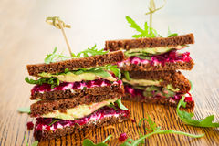 Beet,avocado and arugula sandwich Stock Photos