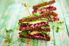 Beet,avocado and arugula sandwich. Sandwich with beet,cheese,avocado and arugula royalty free stock photography