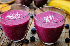 Beet banana coconut blueberry Chia seed smoothies Stock Images