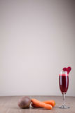 Beet and carrot juice. Freshly squeezed beet and carrot juice decorated with beetroot heart Royalty Free Stock Image