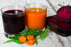 Beet and carrot juice in glasses. vitamin drink Royalty Free Stock Photography