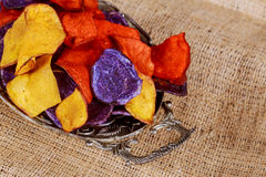 Beet and carrot salty chips in the Potato red blue chips Royalty Free Stock Photos