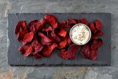 Beet chips with dip, above view on slate Royalty Free Stock Photography