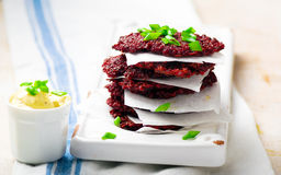 Beet fritters with sauce Royalty Free Stock Images