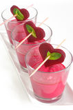 Beet gazpacho, gaspacho. Gazpacho of beet, tomato and sweet bell pepper, with some sour creme, served in glasses with small beet hearts, romantic style Royalty Free Stock Image