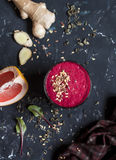 Beet and ginger smoothie. Healthy detox drink. On a dark background Royalty Free Stock Photos