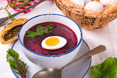 Beet green soup with egg Royalty Free Stock Photo