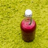 Beet juice in glass bottle. Beet Healthy juice on green background Stock Photos