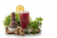 Beet and herbs mix juice. A potrait of a glass beet and herbs mix into a refreshing juice stock photos