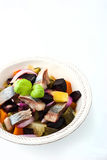 Beet and herring salad on the white dish vertical Stock Images