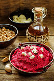 Beet hummus and goat cheese Stock Photos