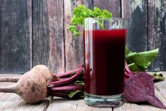 Beet juice against a rustic wooden background Stock Photography