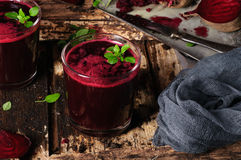 Beet juice. With basil on a wooden background with sunlight Stock Photography