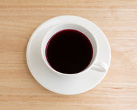 Beet juice in a coffee mug on table Royalty Free Stock Photos