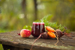Beet juice in glass on  table Royalty Free Stock Images