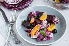 Beet, orange, radicchio, olives salad. Close-up Royalty Free Stock Image