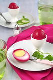 Beet-pickled eggs. Served on the table Stock Images