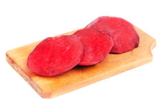 Beet purple vegetable sliced on  cutting board Stock Photo