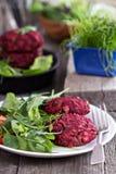 Beet root and red bean vegan burgers. With salad Stock Photos