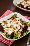 Beet salad with arugula, feta cheese and walnut Royalty Free Stock Photo